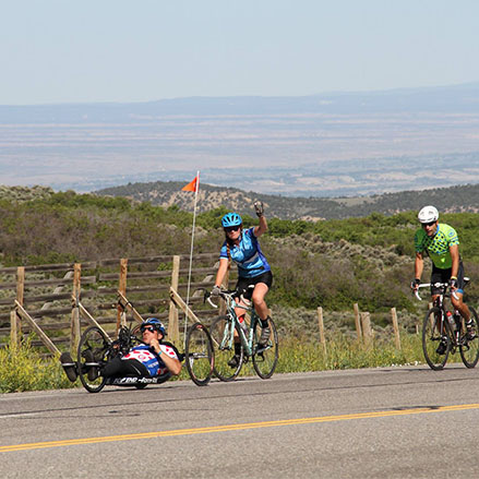 A participant rides a handcycle in Ride the Rockies.