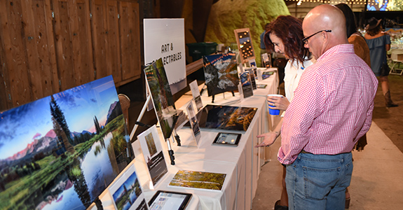 People look at silent auction items at the Crested Butte Open fundraising gala.