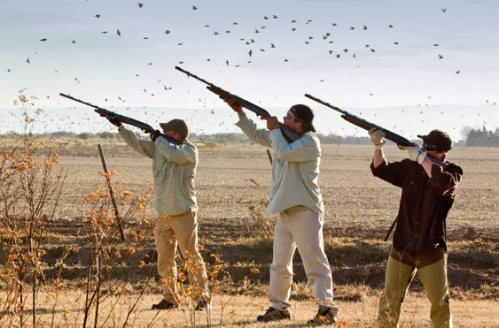 People preparing to hunt birds