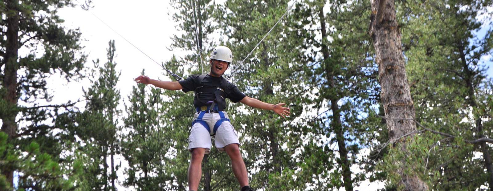 A participant on the ropes challenge course.