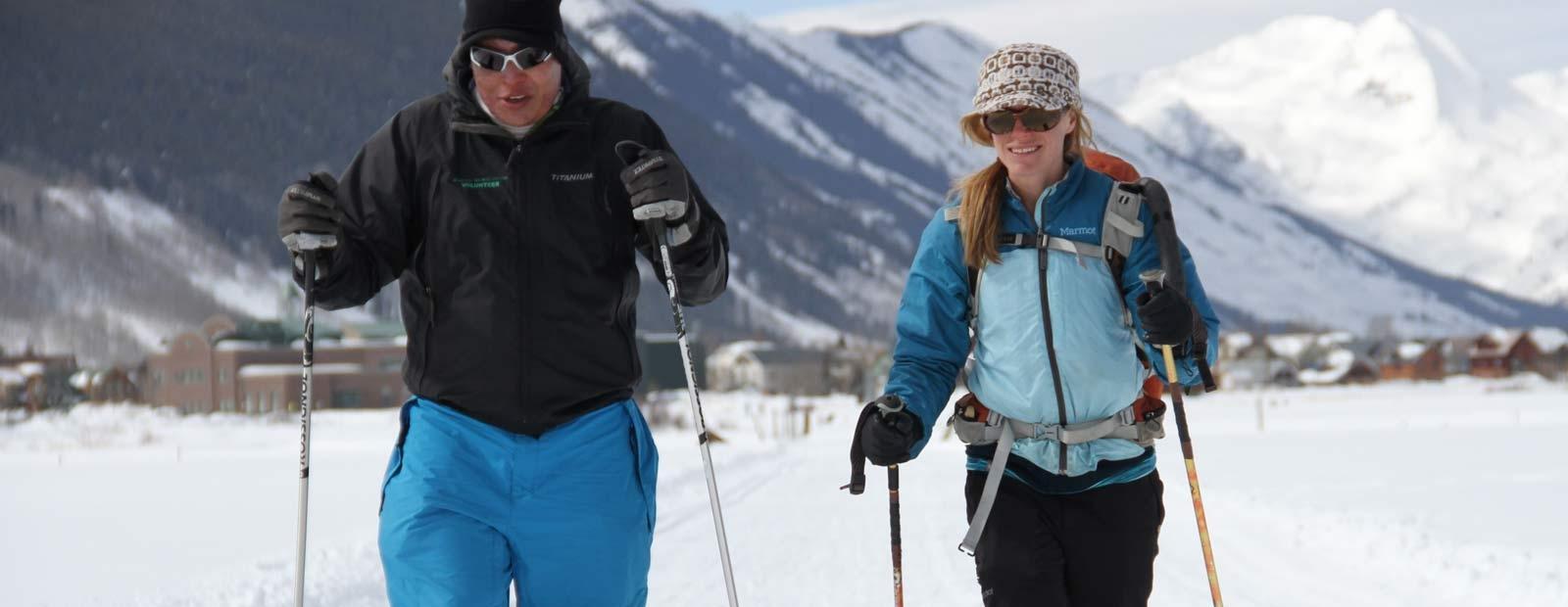 Two people nordic skiing