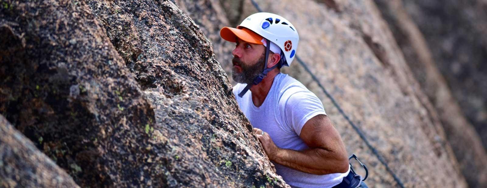 Man climbing up a rock face