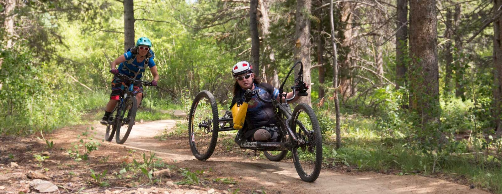 Man racing on offroad hand cycle